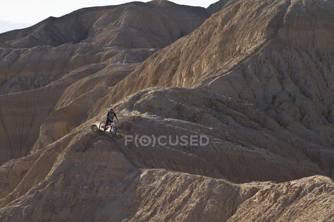 USA, California, Mountain biker cycling on mountain top — Stock Photo