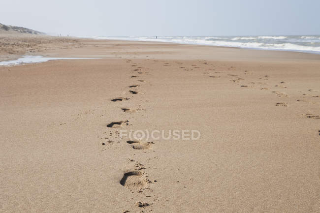 Belgium, Footprints on sand at North Sea — Stock Photo
