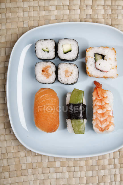Germany, Variety of sushi on plate — Stock Photo