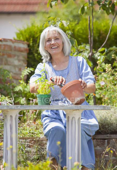 Mature woman gardening, smiling — Stock Photo