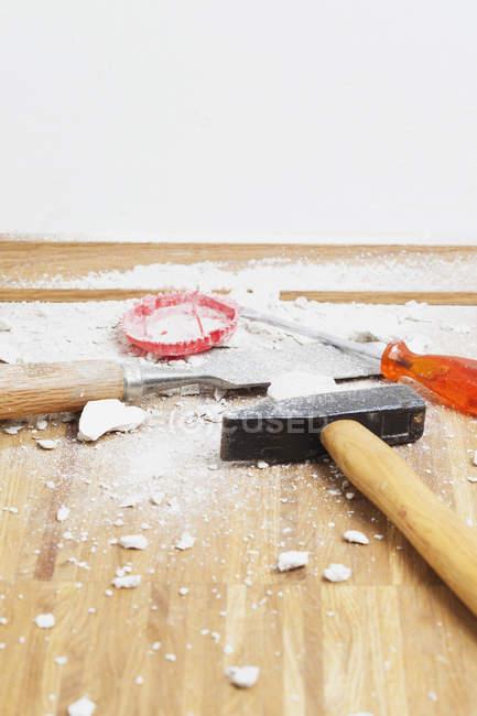 Work tools placed on oak parquet floor — Stock Photo