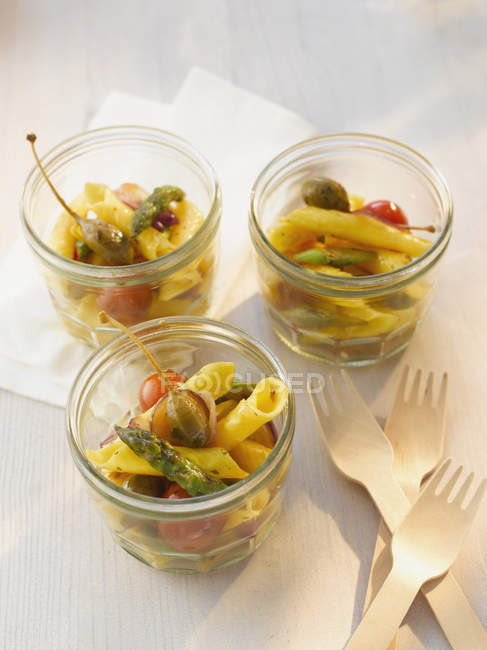 Campanelle pasta salad with asparagus and capers in bowl, close up — Stock Photo