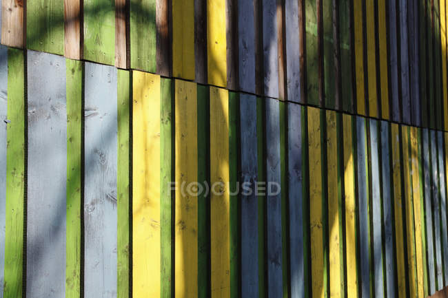 Shadow on coloured wooden wall — Stock Photo
