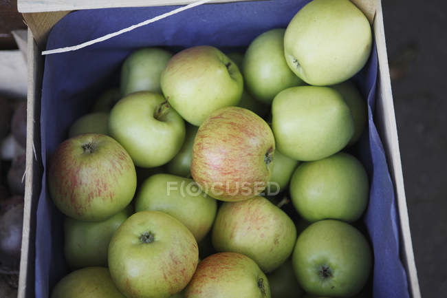 Apples in wooden box — Stock Photo