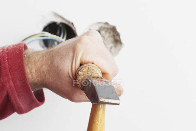 Closeup of male electrician at work with professional tools — Stock Photo