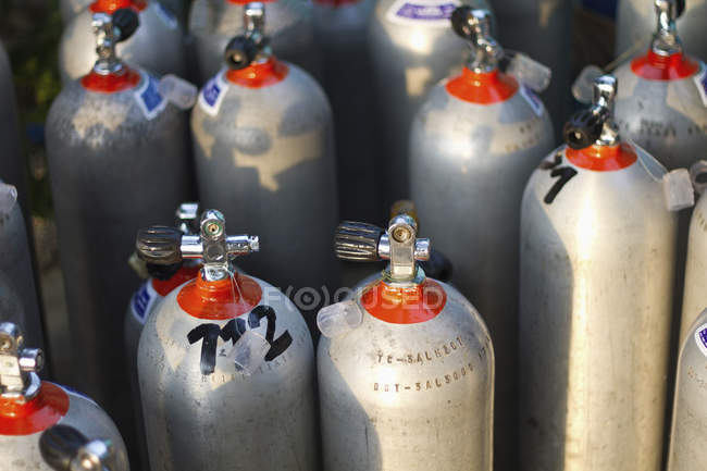 Close-up of Diving tanks in rows in sunlight — Stock Photo
