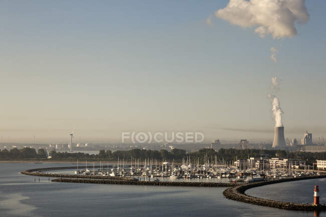 Distant view of harbour and power plant at daytime, Rostock, Germany — Stock Photo