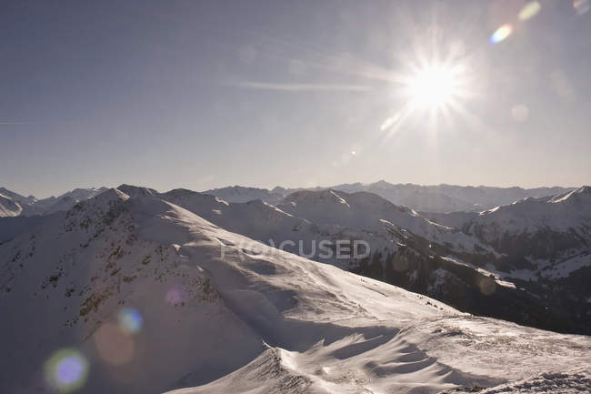 Austria, snow-covered mountains in backlit — Stock Photo