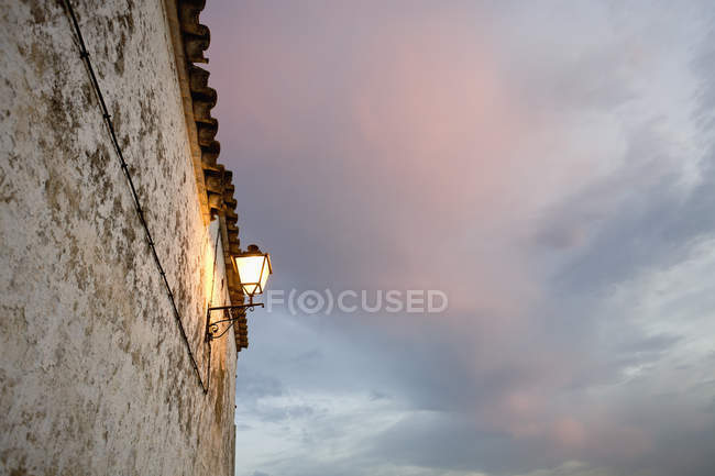 View of lantern on old building at dusk — Stock Photo