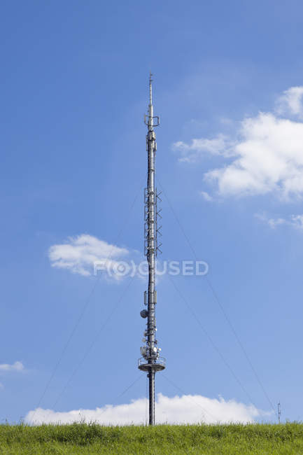 Germany, radio and television antenna and blue sky with clouds on background — Stock Photo