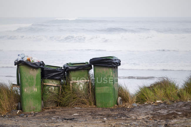 Portugal, Dustbins at beach against water — Stock Photo