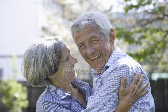 Senior couple smiling outdoors, close up — Stock Photo