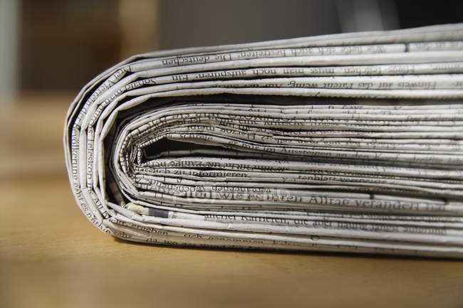 Germany, Bundle of newspapers on table — Stock Photo