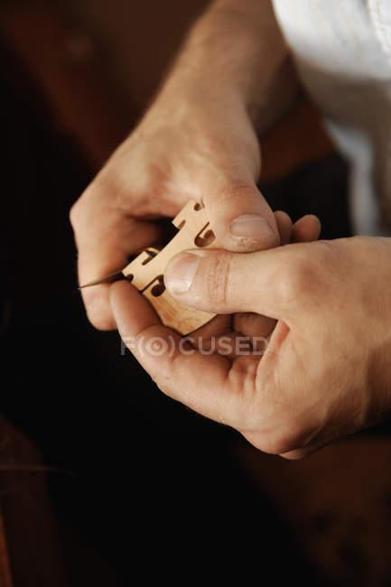 Craftsman making violin — Stock Photo