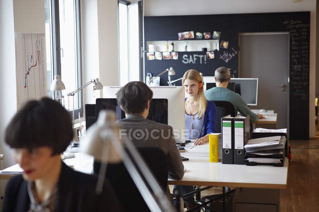 Men and women working in modern office — Stock Photo