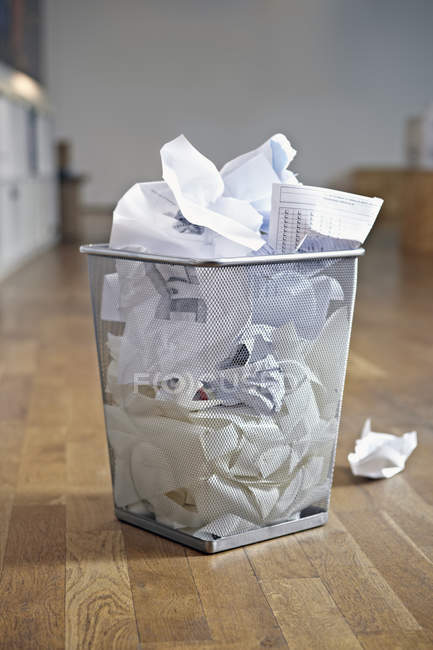 Closeup of basket with waste paper in apartment — Stock Photo