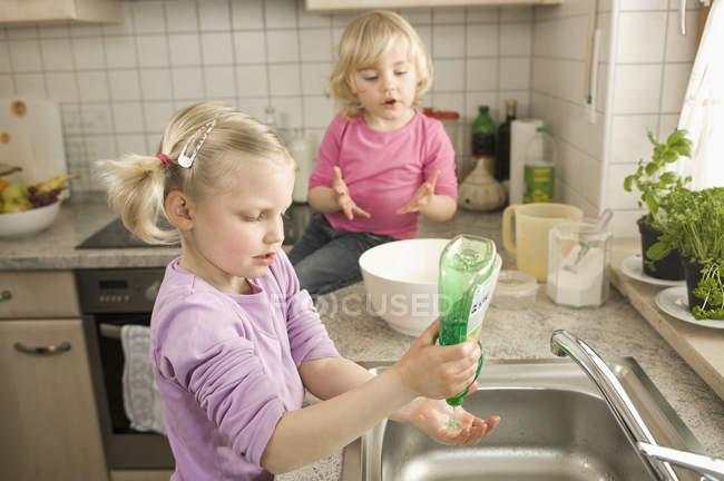 Girl washing hands — Stock Photo