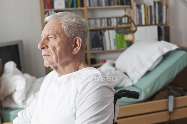 Senior man sitting in wheelchair — Stock Photo