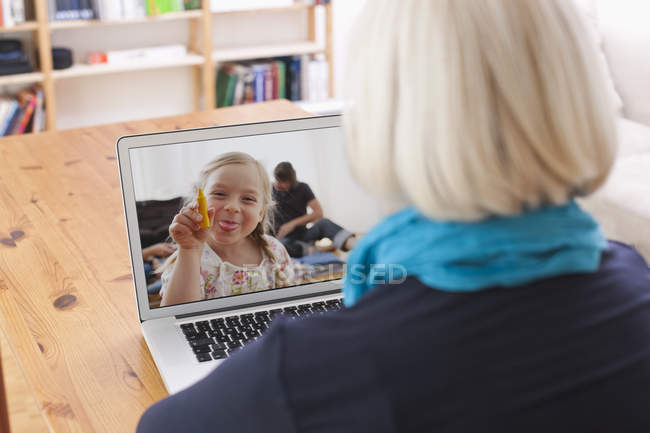 Senior woman in video conference with grandaughter — Stock Photo