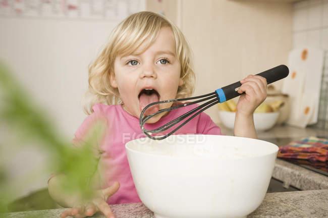 Girl tasting butter — Stock Photo