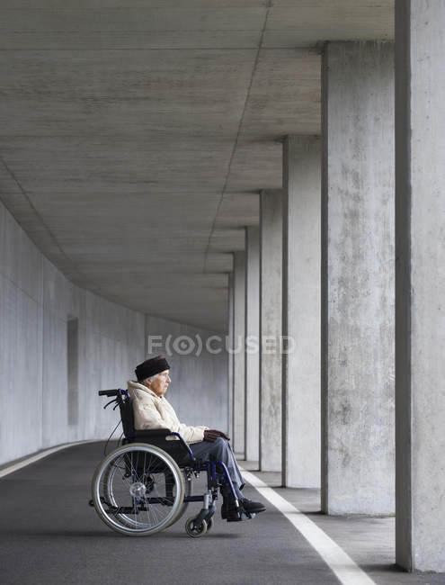 Senior woman sitting on wheelchair — Stock Photo