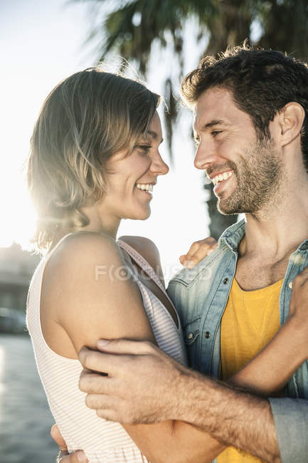Mid adult couple looking at each other, smiling — Stock Photo