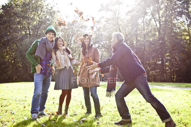 Man and woman enjoying in park, smiling — Stock Photo