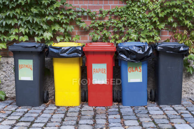 Various garbage containers for ecological separation and recycling in yard in Munich, Germany — Stock Photo