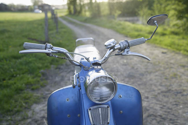 Old moped of 1960s on path in countryside — Stock Photo