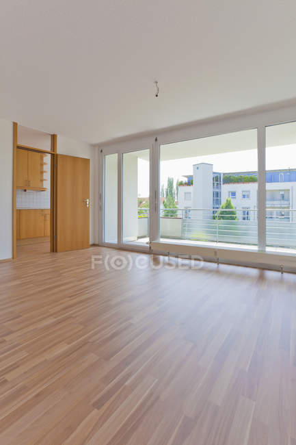 Empty living room interior with balcony — Stock Photo