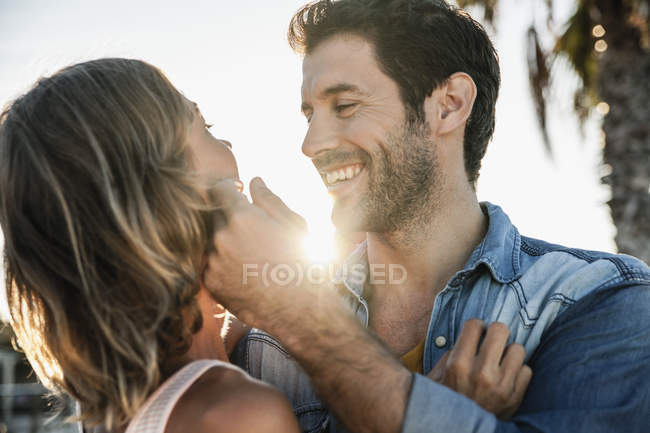 Mid adult couple embracing, smiling — Stock Photo