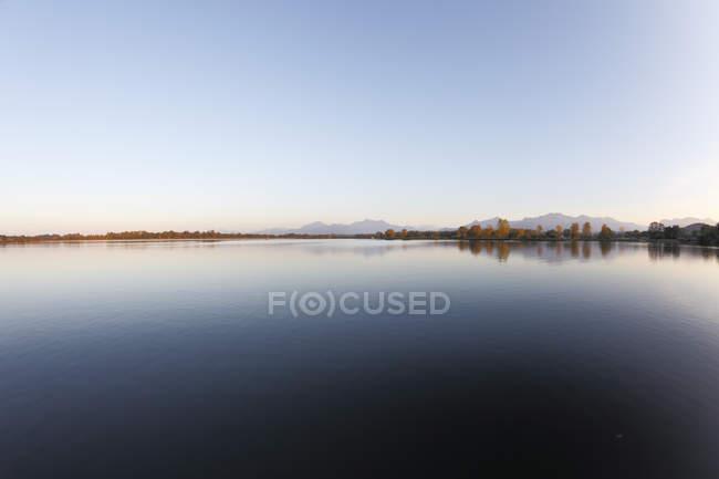 Germany, Bavaria, Upper Bavaria, Chiemgau, Lake Chiemsee at sunset — Stock Photo