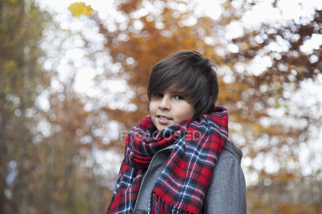 Portrait of Boy smiling outdoors — Stock Photo