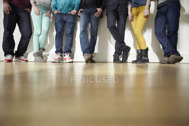 Cropped image of men and women standing on floor — Stock Photo