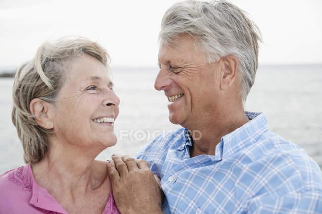Senior couple smiling, close up — Stock Photo