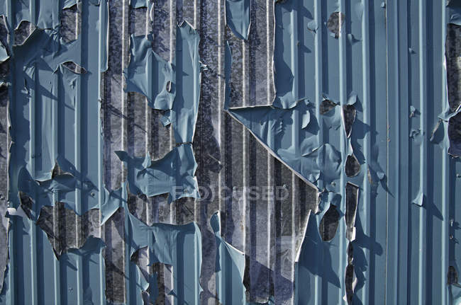 Peeling blue paint on grey metal container — Stock Photo
