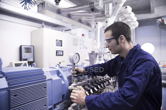 Technician working in a technical room — Stock Photo