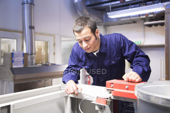 Technician working in technical room — Stock Photo