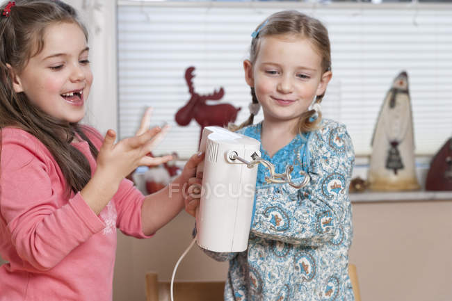 Portrait of two little girls with mixer — Stock Photo
