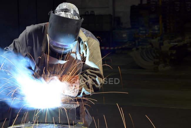 Welder working with grinding machine — Stock Photo