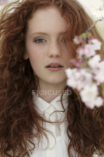 Portrait of daydreaming girl with curly red hair — Stock Photo