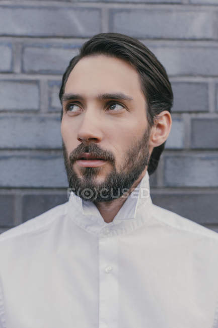 Portrait of young man wearing white shirt — Stock Photo