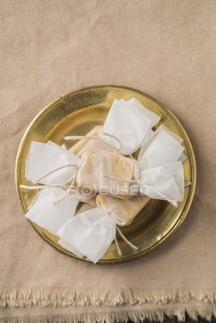 Closeup of homemade toffees in wrapping paper — Stock Photo