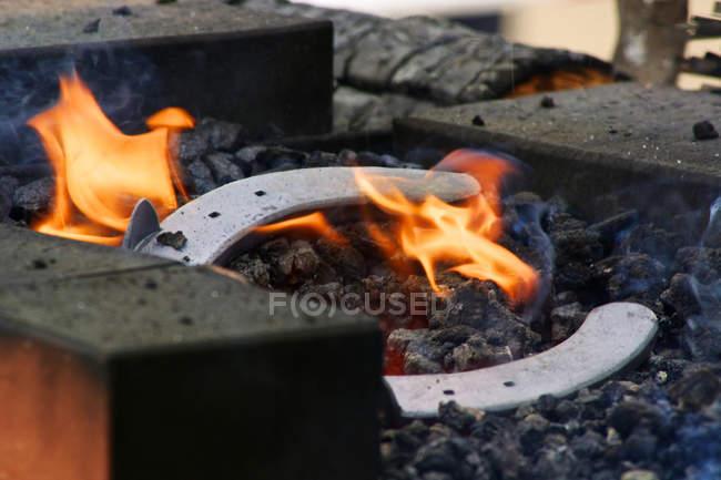 Blacksmith fire with horseshoe outdoors — Stock Photo