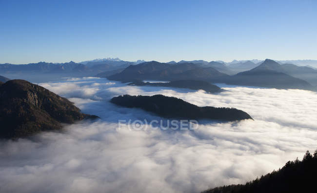 View of alpine foothills covered with fog at daytime, Austria — Stock Photo