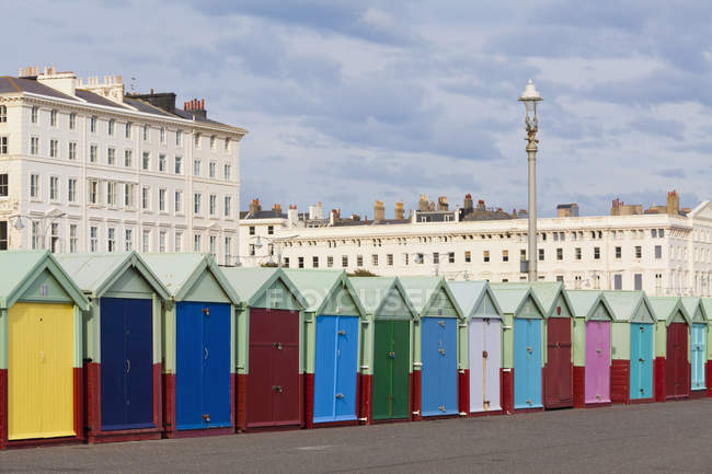 Coloured bathing huts at seafront — Stock Photo