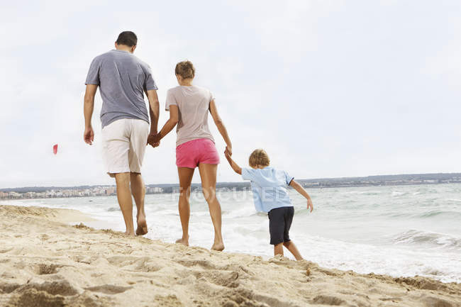 Family Walking On Beach At Palma De Mallorca Spain Male Mid Adult Woman Stock Photo 184352076