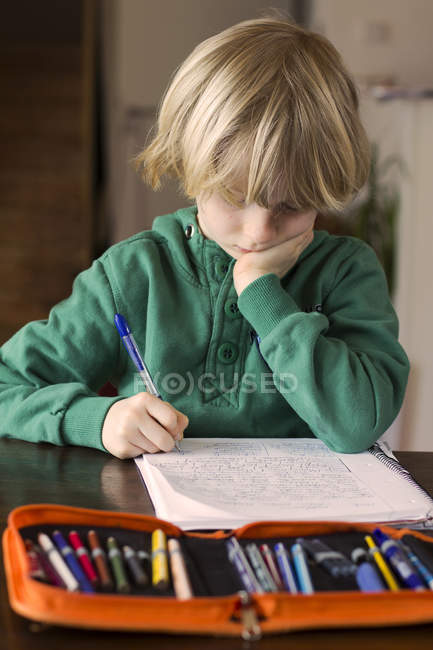 Boy doing his schoolwork — Stock Photo