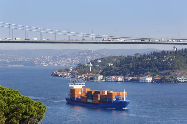 Fatih Sultan Mehmet Bridge or the Second Bosphorus Bridge, cargo ship on Bosphorus, Istanbul, Turkey — Stock Photo