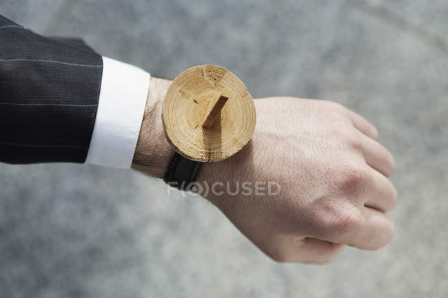 Human hand with sundial wrist watch, close up — Stock Photo